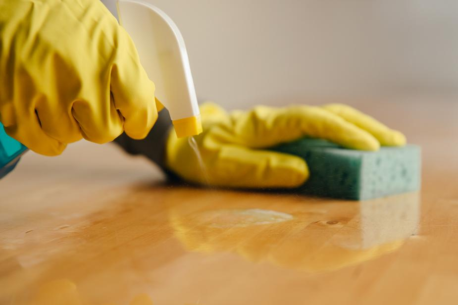 spraying cleaner on wood